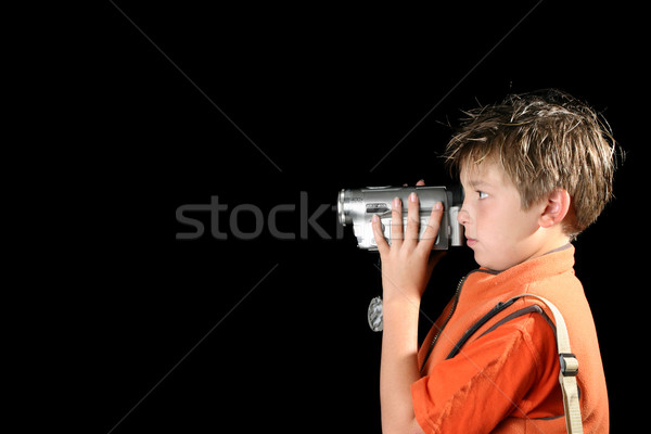 Stock photo: Child using a home video camera