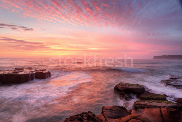 Sunrise skies and white water seas Stock photo © lovleah