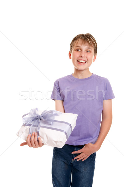 Smiling boy holds a gift wrapped present Stock photo © lovleah