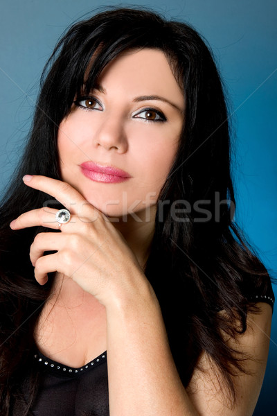 Beautiful brunette woman thinking Stock photo © lovleah