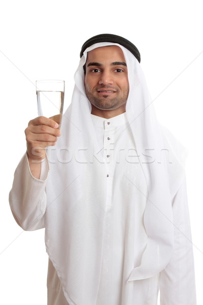 Happy arab man holding a glass of fresh drinking water Stock photo © lovleah