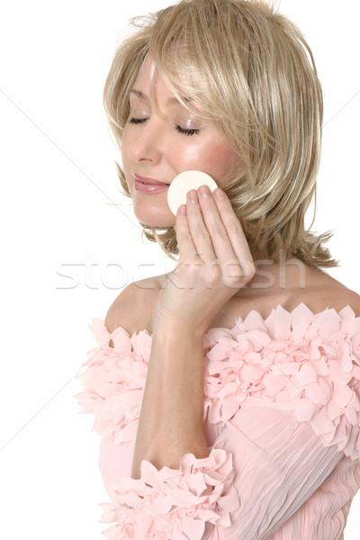 Woman using makeup applicator Stock photo © lovleah