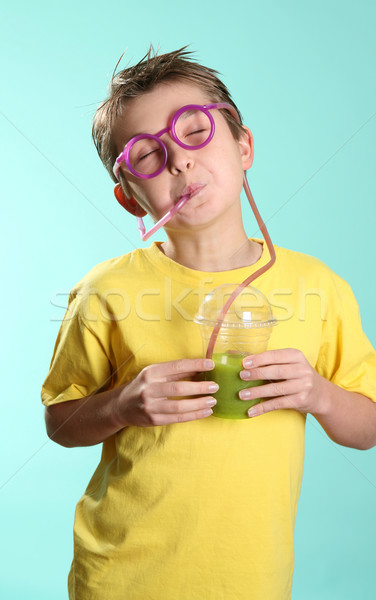 Stock photo: Fruitilicious - boy drinking through a crazy straw