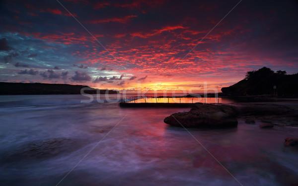 Sansasyonel gündoğumu kaya havuz Sidney Stok fotoğraf © lovleah