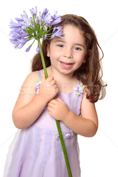 Little girl holding large african lily - agapanthus Stock photo © lovleah