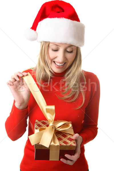 Female opening a Christmas present Stock photo © lovleah