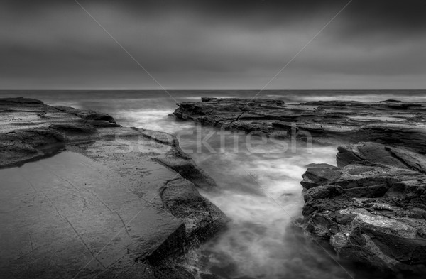 Moody seascape ocean rock channel Stock photo © lovleah