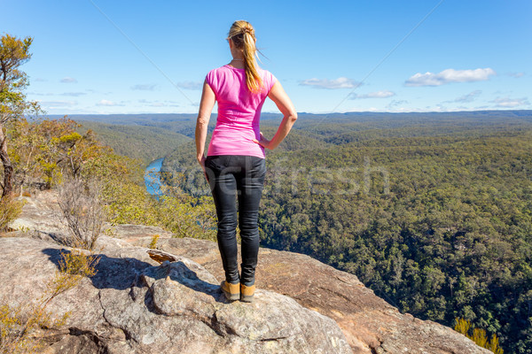Bush walker admiring views high above the river Stock photo © lovleah