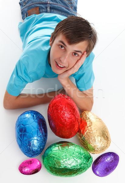 Fiú köteg csokoládé húsvéti tojások mosolyog kicsi Stock fotó © lovleah