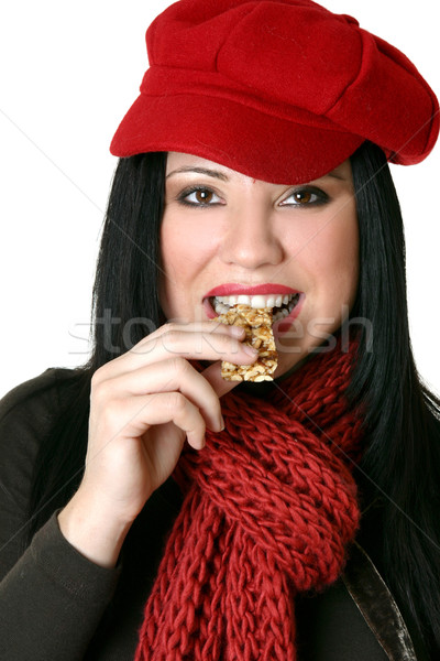 Female eating healthy nut bar Stock photo © lovleah