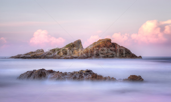Statis Rock  off Sugarloaf Bay Seal Rocks NSW Australia at sunse Stock photo © lovleah