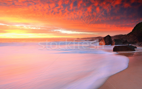 Foamy white seas and vivid sunrise Stock photo © lovleah
