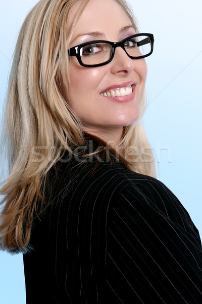 Confident business woman worker looking over shoulder and smilin Stock photo © lovleah