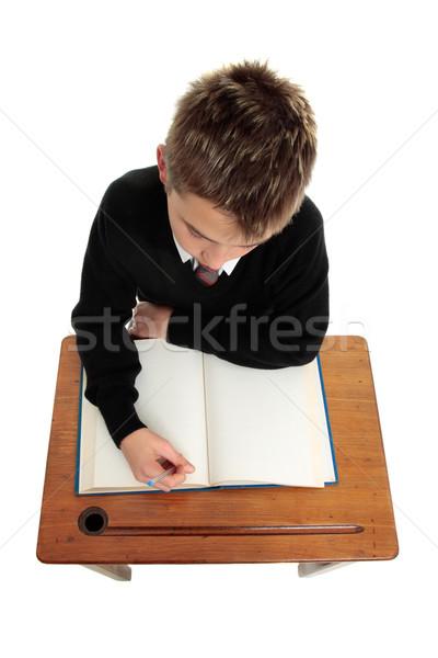 男子生徒 学生 座って デスク 開いた本 ペン ストックフォト © lovleah