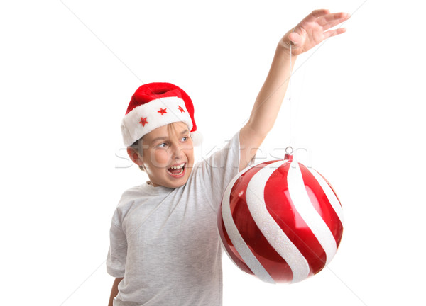 Boy with an oversized Chirstmas Bauble Stock photo © lovleah