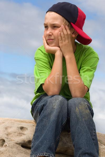 Gyermek sapka néz kilenc éves fiú kő Stock fotó © lovleah