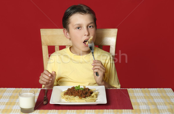 Child eating pasta penne  Stock photo © lovleah