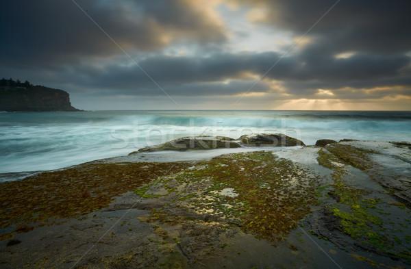 Moody day over Bilgola rockshelf Australia Stock photo © lovleah