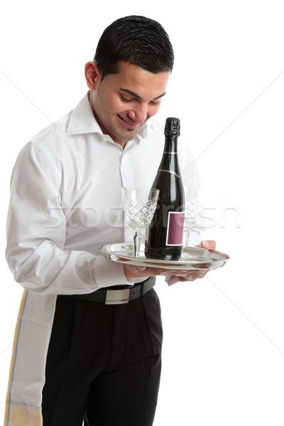 Mosolyog pincér szolgáló csapos hordoz borosüveg Stock fotó © lovleah
