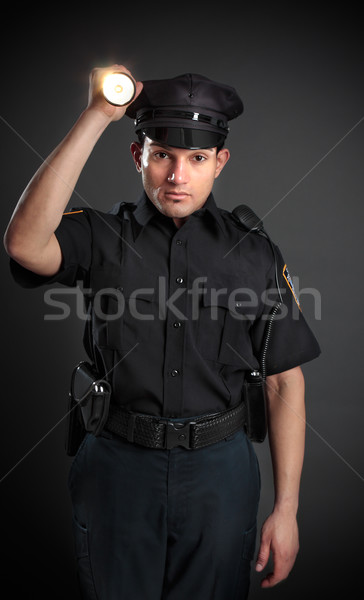Policeman or Security Guard shining a torch Stock photo © lovleah