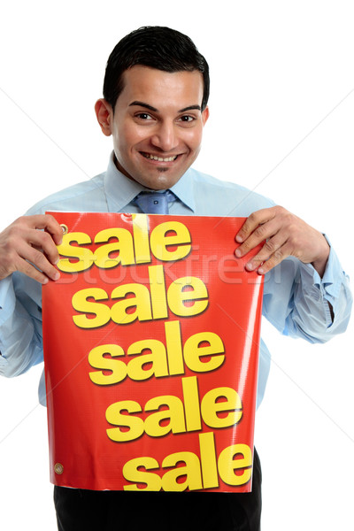 Retailer with sale sign Stock photo © lovleah