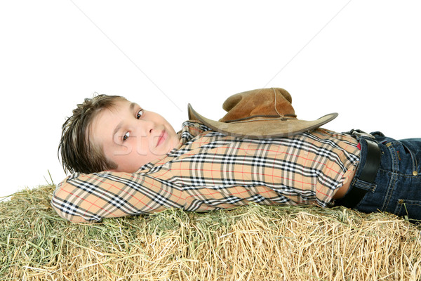 Country boy resting on hay Stock photo © lovleah