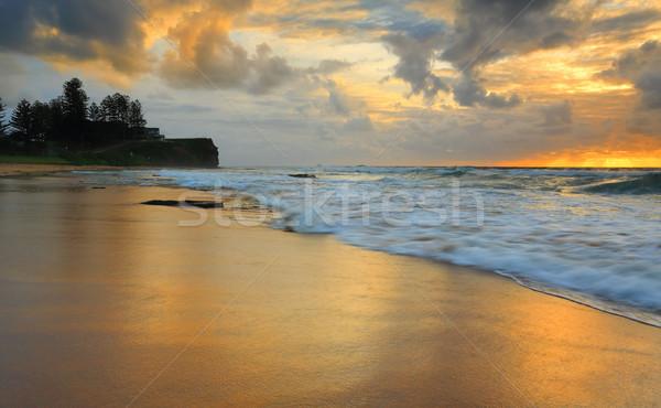 Pequeno praia nascer do sol norte olhando ponto Foto stock © lovleah