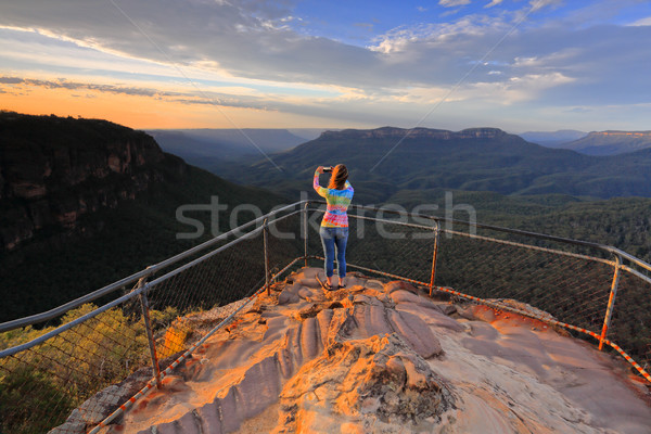 Capturing a photo of sunrise mountain lookout Stock photo © lovleah