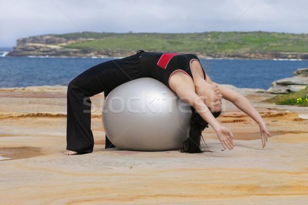 Pilates labda visszafelé hát kanyar lány Stock fotó © lovleah