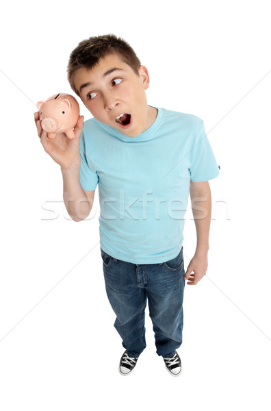 Surprised boy shaking money box Stock photo © lovleah