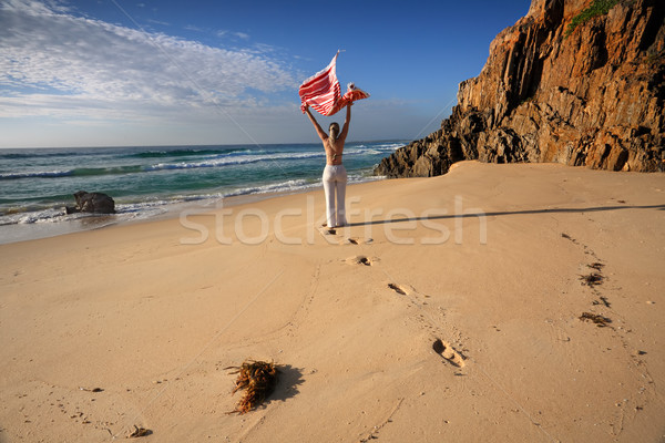 A woman walks along the beach, travel, health and wellbeing Stock photo © lovleah