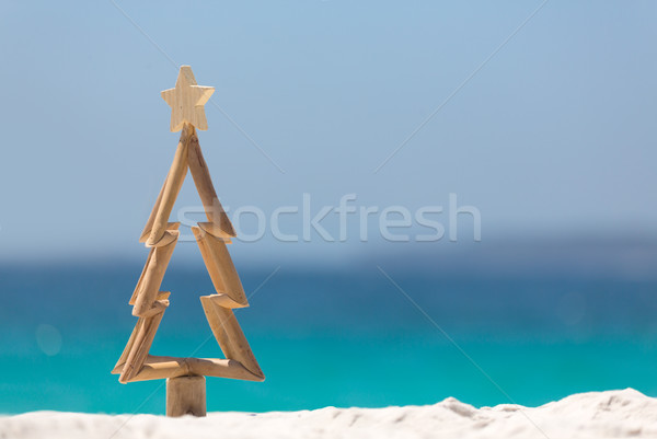 Timber Christmas tree in sand on the beach Stock photo © lovleah