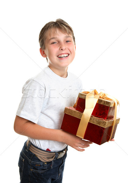 Jubilant child carrying presents Stock photo © lovleah