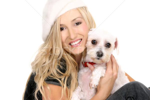 Sitting girl cuddling a dog Stock photo © lovleah