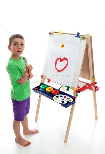 Fiatal gyermek áll művészet festőállvány fiatal srác Stock fotó © lovleah