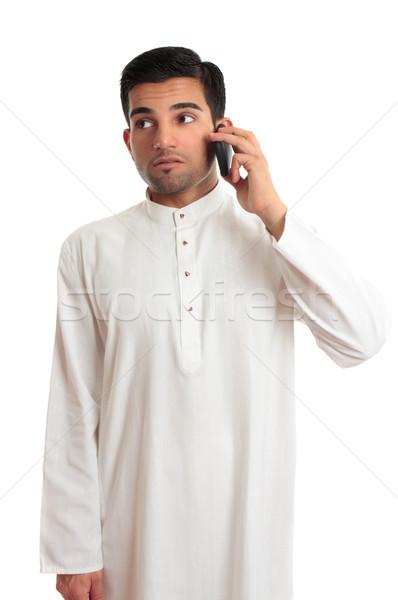 Ethnic businessman on cellphone Stock photo © lovleah