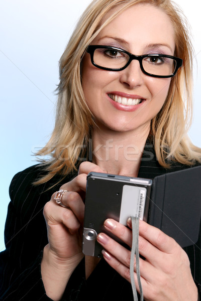 Businesswoman using a pda organizer Stock photo © lovleah