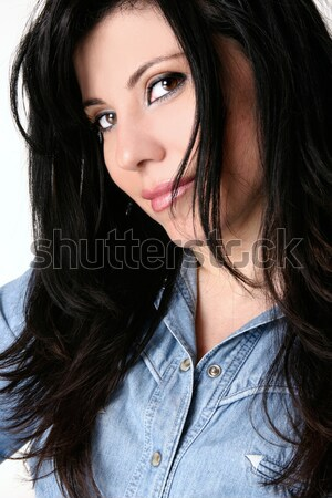 Woman tousling long hair with fingers Stock photo © lovleah