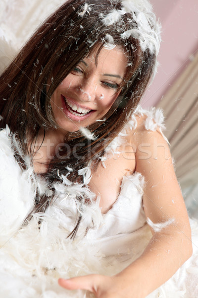 Happy woman among feathers Stock photo © lovleah