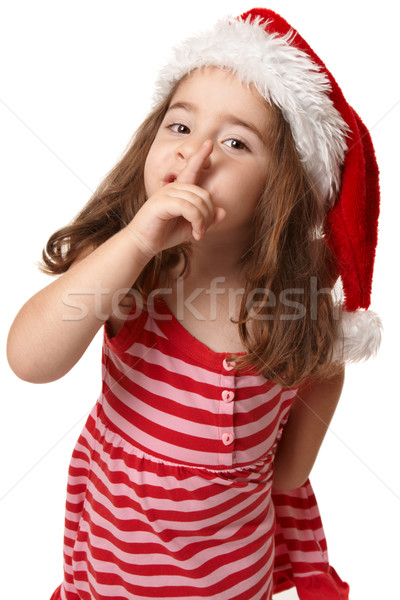 Little girl in santa hat gesturing peace and quiet Stock photo © lovleah