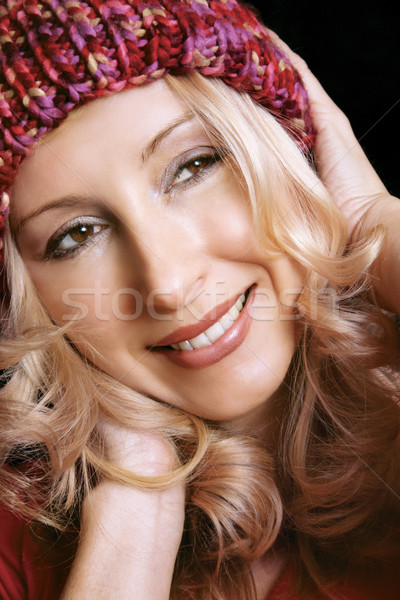 Smiling girl wearing beannie Stock photo © lovleah