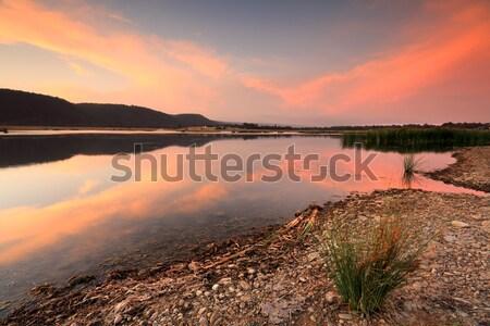 Yaz gün batımı bankalar kuzey mavi dağlar Stok fotoğraf © lovleah