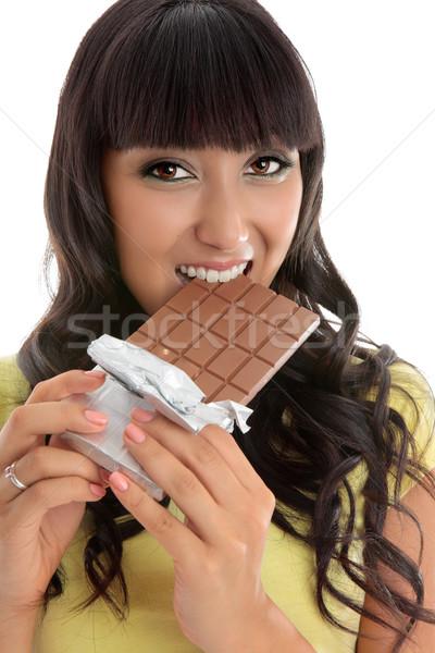 Beautiful girl eating decadent chocolate bar Stock photo © lovleah