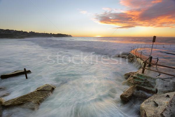 ビーチ 日の出 波 サージ オーストラリア 雲 ストックフォト © lovleah