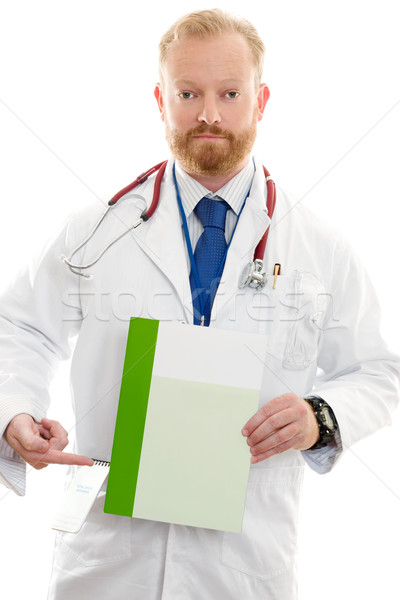 Male Doctor with Information or Brochure Stock photo © lovleah