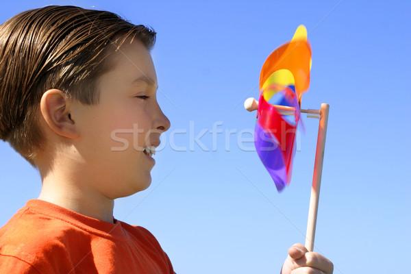 Boy playing with  spinning wheel pinwheel toy Stock photo © lovleah
