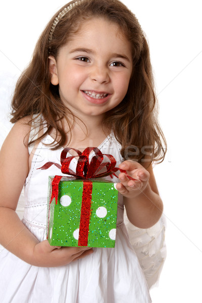 Angelic girl holding a gift Stock photo © lovleah