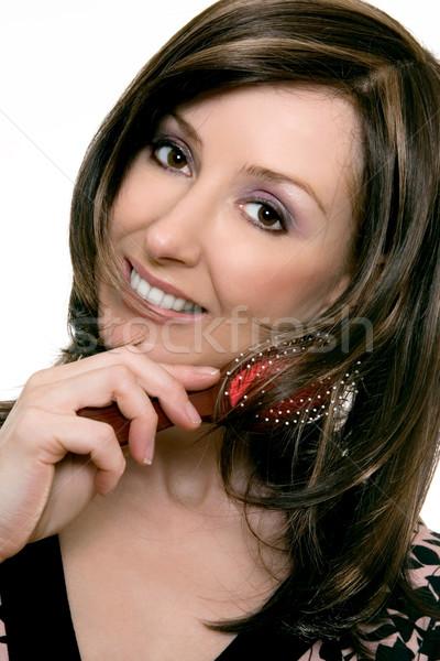 Haircare - Female using a hair brush Stock photo © lovleah