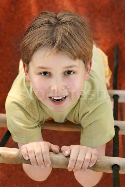 Climbing a rope ladder at playground Stock photo © lovleah