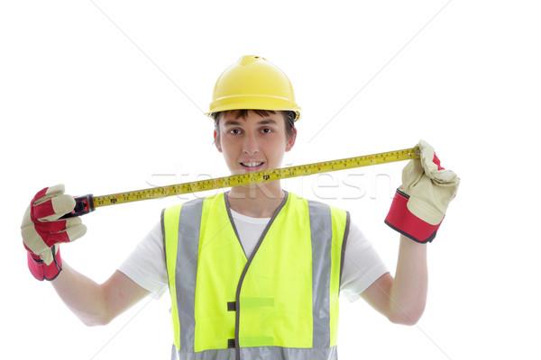 Apprentice holding builders tape measure Stock photo © lovleah